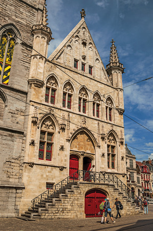 Ghent, Belgium - July 03, 2017. People, Gothic buildings and blue sky in Ghent. In addition to intense cultural life, the city is full of canals and buildings in Flemish style. Northern Belgium. Editorial