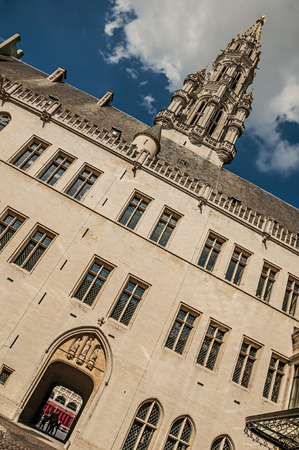 City Hall building and its gothic tower intentionally crooked at the Grand Place of Brussels. Vibrant and friendly, is the country's capital and administrative center of the EU. Central Belgium. Stock Photo