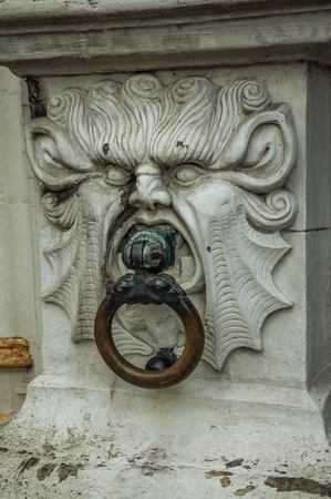 Rich and elegant marble frown adorning the historic building at City Center of Bruges.