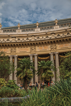 Paris, France - July 11, 2017. People and garden pond in the courtyard of Petit Palais in Paris. Known as the