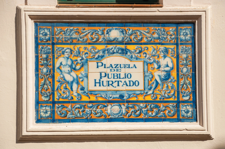 Indicative sign of square name made by colored tiles painted by hand in Caceres. A cute and charming town with a fully preserved medieval city center in western Spain.