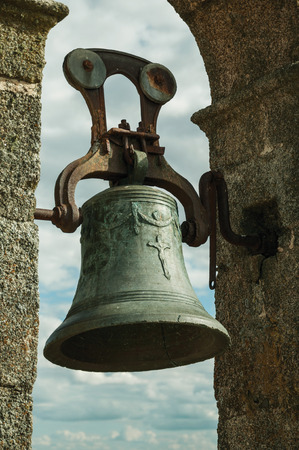 Close-up of bronze bell where can be seen details carved on the surface, at the Castle of Trujillo. A small medieval town, birthplace of the Conquistador Francisco Pizarro in western Spain.