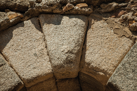 Close-up of keystone (or capstone), the wedge-shaped stone piece at the apex of a masonry arch at Merida. Founded by ancient Rome in western Spain, the city preserves many buildings of that era. 写真素材