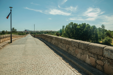 Pavement made of setts on top of Puente Romano, an old bridge still in use over the Guadiana River at Merida. Founded by ancient Rome in western Spain, the city preserves many buildings of that era. Фото со стока