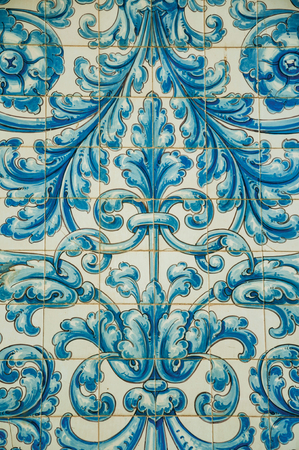 Splendid blue floral pattern hand-painted on ceramic tiles in an old building facade at Caceres. A cute and charming countryside old village, full of gothic building in western Spain.