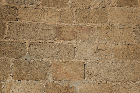 Close-up of old wall made of large stone bricks, forming a charming pattern at Caceres. A cute and charming town with a fully preserved medieval city center in western Spain. 스톡 콘텐츠