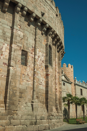 Back of the Cathedral merged with the city wall made of stone, in a sunny day at Avila. It has the longest and imposing wall completely encircling this well-kept gothic town in Spain. Editorial