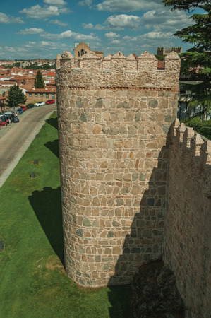 Ancient thick wall with battlement and large towers made of stone encircling the town of Avila. It has the longest and imposing wall completely encircling this well-kept gothic town in Spain.