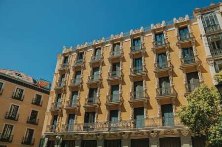 Madrid, Spain - July 24, 2018. Old building with colorful facade and windows with iron balustrade in Madrid. Capital of Spain this charming metropolis has vibrant and intense cultural life.