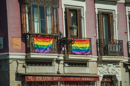 Madrid, Spain - July 24, 2018. Rainbow flags (LGBT movement) tied on balustrade in old building balconies at Madrid. Capital of Spain this charming metropolis has vibrant and intense cultural life. Editorial