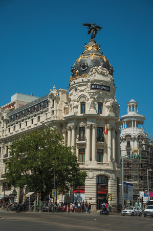 Madrid, Spain - July 25, 2018. Old buildings on the busy Alcala Street with people and cars, in a sunny day at Madrid. Capital of Spain this charming metropolis has vibrant and intense cultural life.