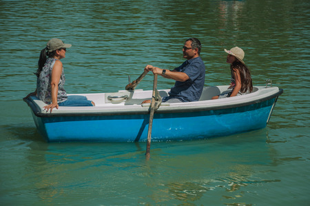 Madrid, Spain - July 25, 2018. Family paddling boat on the reflecting pool at El Retiro Park, in a sunny day at Madrid. Capital of Spain this charming metropolis has vibrant and intense cultural life.