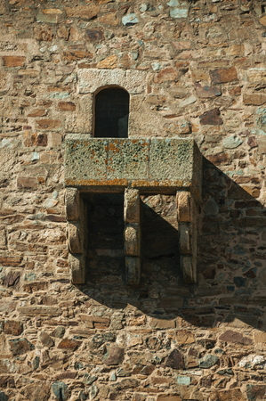 Close-up of stone balcony on gothic tower, in a sunny day at Caceres. A cute and charming town with a fully preserved medieval city center in western Spain.