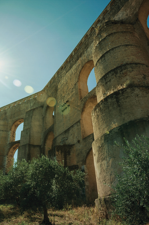 Architectural structure of the Amoreira Aqueduct with arches and rectangular pillars in a sunny day at Elvas. A gracious star-shaped fortress city on the easternmost frontier of Portugal.