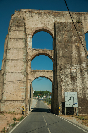 Architectural structure of the Amoreira Aqueduct with arches and rectangular pillars on the road to Elvas. A gracious star-shaped fortress city on the easternmost frontier of Portugal.