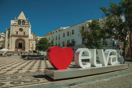 Elvas, Portugal - July 07, 2018. Large signpost with the city name and church of Our Lady of the Assumption at Elvas. A gracious star-shaped fortress city on the easternmost frontier of Portugal.