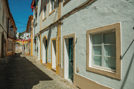 Portalegre, Portugal - July 8, 2018. Alley with festive colorful decoration and old terraced houses at Portalegre. A nice little town at the bottom of Mamede Mountain Range in eastern Portugal.