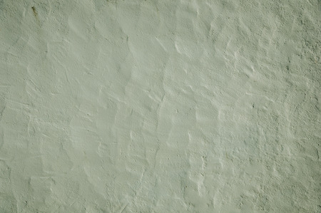 Close-up of wall covered by white plaster with some flaws and granulation, forming a singular background at Marvao. An amazing medieval fortified village perched on a granite crag in eastern Portugal.