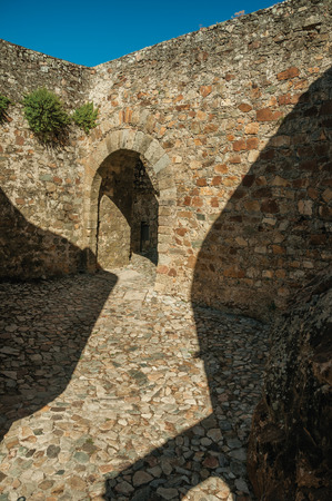 Close-up of arched gateway in the stone internal wall, in a sunny day at the Marvao Castle. An amazing medieval fortified village perched on a granite crag in eastern Portugal.