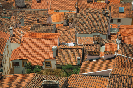 Cityscape with many rooftops on a sunny day, forming a singular pattern at Castelo de Vide. Nice little town with medieval castle to ensure the defense of the Portugal eastern border.