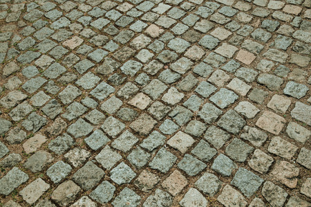 Pavement made of granite setts forming a singular background, in a sunny day at Monsanto. Considered one of the cutest and most peculiar historic village of Portugal. Banco de Imagens