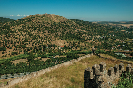 Landscape with the Fort of Nossa Senhora da Graça on top of hill and Castle walls in sunny day at Elvas. A gracious star-shaped fortress city on the easternmost frontier of Portugal. Imagens