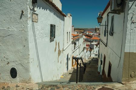 Campo Maior, Portugal - Alley going down the slope with steps among old houses at Campo Maior. A cute little town with Roman, Moorish and medieval influences in eastern Portugal.