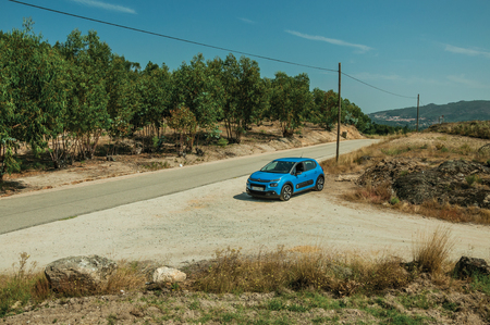 Monsanto, Portugal - July 13, 2018. Car stop on a countryside dirt road in rocky landscape with trees near Monsanto, considered one of the cutest and most peculiar historic village of Portugal. Editorial