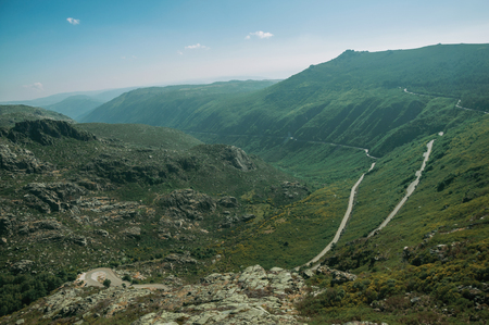 Long road on Zezere River valley, a canyon formed by glacier thousands of years ago, in a sunny day at Serra da Estrela. The highest mountain range in continental Portugal, with astonishing scenery. 写真素材