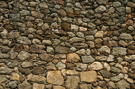 Close-up of old wall made of large rough stones forming a singular background at Linhares da Beira. A medieval hamlet with unique architectural diversity fruit of several times, in eastern Portugal. Banco de Imagens