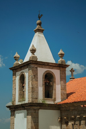 Bell tower from church in baroque style with exquisite stone decoration at Linhares da Beira. A medieval hamlet with unique architectural diversity fruit of several times, in eastern Portugal. Banco de Imagens