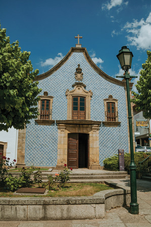 Gouveia, Portugal - July 17, 2018. Facade covered by ceramic tiles at the Church of the Misericordia of Gouveia. A nice country town with gardens and captivating historical heritage in Portugal.
