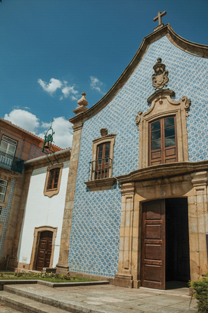 Facade in baroque style covered by colorful ceramic tiles, at the Church of the Misericordia of Gouveia. A nice country town with gardens and captivating historical heritage in Portugal.
