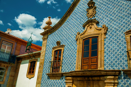 Facade in baroque style covered by colorful ceramic tiles, at Church of the Misericordia of Gouveia. A nice country town with gardens and captivating historical heritage in Portugal. Retouched photo. Banco de Imagens - 124404103