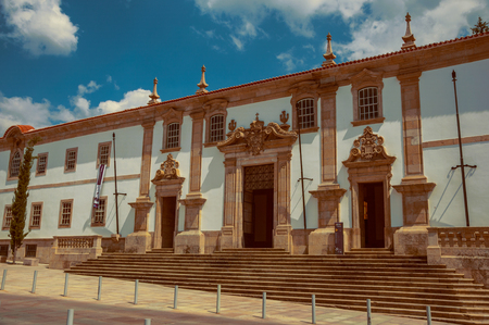 Gouveia, Portugal - July 17, 2018. Facade of Town Hall building in baroque style at Gouveia. A nice country town with gardens and captivating historical heritage in Portugal. Vintage filter. Banco de Imagens - 124404117