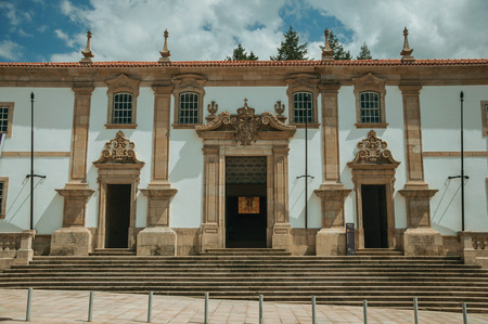 Huge door and steps on the Town Hall building facade finery decorated in baroque style, in a sunny day at Gouveia. A nice country town with gardens and captivating historical heritage in Portugal. Banco de Imagens
