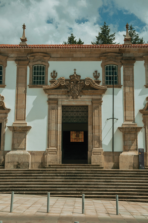 Huge door and steps on the Town Hall building facade finery decorated in baroque style, in a sunny day at Gouveia. A nice country town with gardens and captivating historical heritage in Portugal. Stock Photo