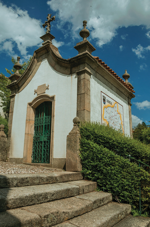Gouveia, Portugal - July 17, 2018. Small chapel finery decorated in baroque style next to stone staircase at Gouveia. A nice country town with gardens and captivating historical heritage in Portugal.