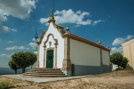 Gouveia, Portugal - July 17, 2018. Chapel of the Lord of Calvary in baroque style in a garden of Gouveia. A nice country town with gardens and captivating historical heritage in Portugal. Banco de Imagens - 124404053