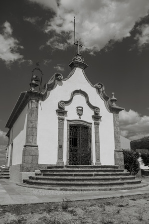 Chapel of the Lord of Calvary finery decorated in baroque style on top of hill at Gouveia. A nice country town with gardens and captivating historical heritage in Portugal. Black and white photo.