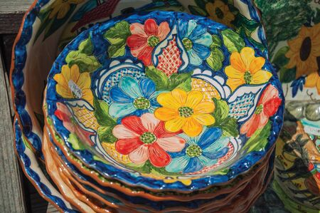 Colorful handmade porcelain dishes, typical of the region, in a gift shop at the Serra da Estrela. The highest mountain range in continental Portugal, with astonishing scenery.