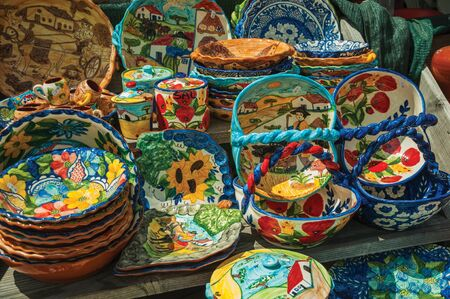 Colorful handmade porcelain pots and dishes, typical of the region, in a gift shop at the Serra da Estrela. The highest mountain range in continental Portugal, with astonishing scenery.