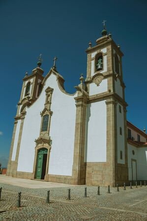 Church of Our Lady of the Assumption, facade in baroque style on a sunny day at Seia. On foothill mountains, this friendly town in eastern Portugal is also known for its delicious artisanal cheese. Stok Fotoğraf - 127035996