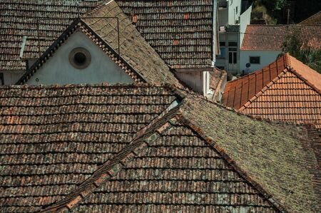 Several house roofs covered with moss and lichens, in a sunny day at Seia. On foothill mountains, this friendly town in eastern Portugal is also known for its delicious artisanal cheese. Stok Fotoğraf - 127035930