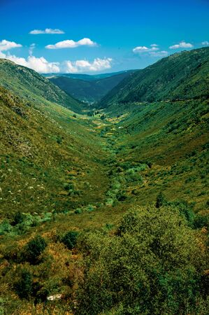 Zezere River valley, a long green canyon formed by glacier thousands of years ago at the Serra da Estrela. The highest mountain range in continental Portugal, with astonishing scenery. Retouched photo