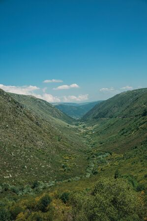 Zezere River valley, a long green canyon formed by glacier thousands of years ago, in a sunny day at Serra da Estrela. The highest mountain range in continental Portugal, with astonishing scenery. Фото со стока