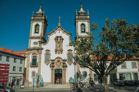 Guarda, Portugal - July 16, 2018. Church of the Misericordia in baroque style and leafy tree on a square of Guarda. This friendly and well-kept medieval town is the highest in the continental Portugal
