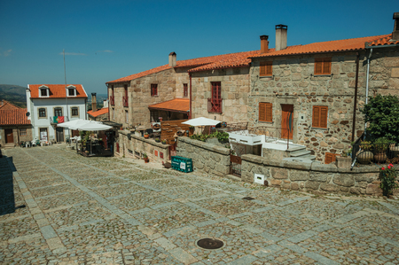 Linhares da Beira, Portugal - July 17, 2018. Square with stone old houses at Linhares da Beira. A medieval hamlet with unique architectural diversity fruit of several times, in eastern Portugal.
