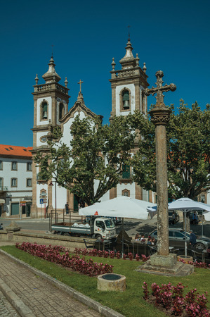 Guarda, Portugal - July 16, 2018. Church of the Misericordia and pillory in baroque style on a square of Guarda. This friendly and well-kept medieval town is the highest in the continental Portugal.