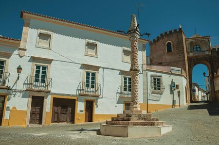 Deserted square of Santa Clara with marble pillory in the Manueline style and old buildings, on sunny day at Elvas. A gracious star-shaped fortress city on the easternmost frontier of Portugal. Reklamní fotografie